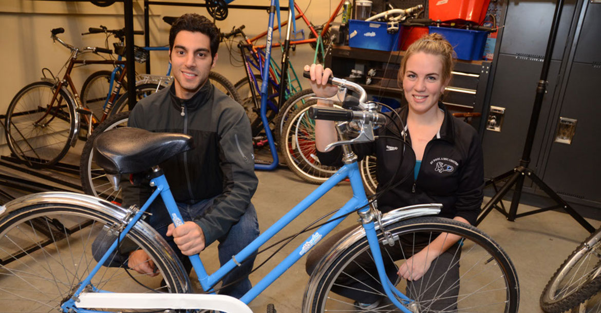 ubcycles team posing with a bike